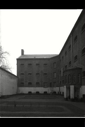 Het Pandreitje, historisch gevangenisgebouw: cellenblokken, exterieur, gevelaanzicht met koer en rotonde, algemeen zicht (gesloopt in 1992)