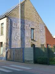 Reclamemuurschildering voor Comptoir Commercial du Caoutchouc